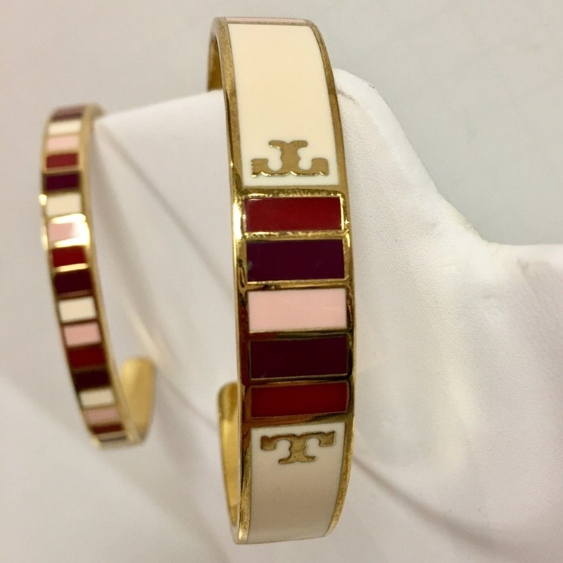 "TORY BURCH ""GEO"" CUFF BRACELET<br /> Stripes of colors & two Tory Burch Signature ""T""s<br /> Colors: Pink, Purple, Maroon, Beige<br /> Width: 7/16""<br /> One Size: Cuff may be bent to fit.<br /> Very Good Pre-Loved condition!<br /> <br /> *Coordinates with our Tory Burch Cuff Bracelet #139276"
