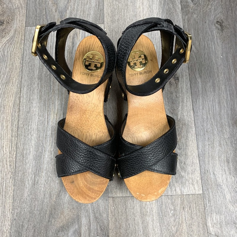 Great condition Tory Burch Wedges<br /> Wooden heel with leather straps<br /> Size 6<br /> *some water marks on left shoe as pictured.  There is also a small blemish on the same shoe as pictured*