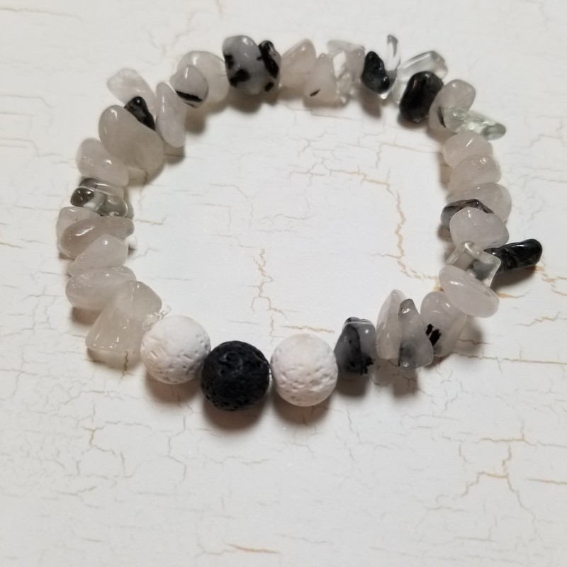 Diffuser Bracelet with beautiful glass beads and diffuser beads for essential oils. Sturdy stretchy band for comfort. Grey, clear, black and white.