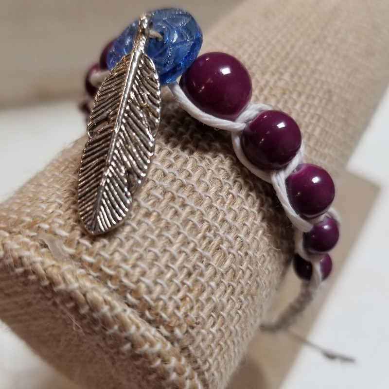 Hemp Bracelet with purple beads. Feather charm. Handcrafted and adjustable.
