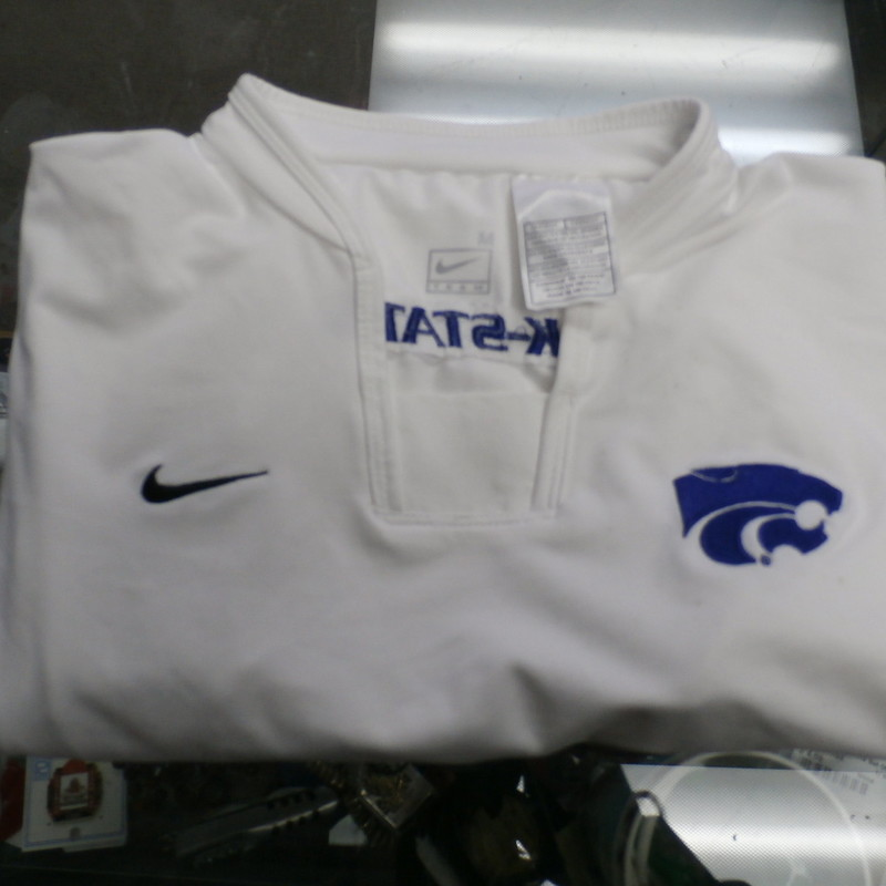 "K State Shirt, White, Size: Medium<br /> Nike Women's Kansas state Wildcats shirt white size Medium poly blend #28816<br /> Rating: (see below) 4- Fair Condition<br /> Team: Kansas state Wildcats<br /> Player: N/A<br /> Brand: Nike<br /> Size:  women's Medium  (Measured Flat: Across chest 17""; Length 25"")<br /> Measured Laying Flat: armpit to armpit; top of shoulder to bottom hem<br /> Color: White<br /> Style: Short sleeve shirt; Embroidered<br /> Material: 82% Polyester 18% Spandex<br /> Condition: 4- Fair Condition: wrinkled; pilling and fuzz; discoloration from use; some light stains on front;<br /> Item #: 28816<br /> Shipping: FREE"