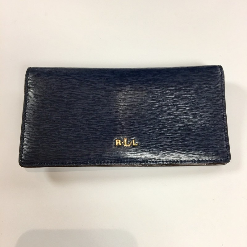 "Lauren Ralph Lauren Wallet<br /> Color: Navy<br /> Material: Saffiano Leather & gold Hardware<br /> Preowned and excellent condition *slight wear on RLL metal monogram letter on front of wallet (see photo)<br /> Measurements: 6-7/8"" w, 3-1/2"" h, 3/4"" deep (at widest point)<br /> Features:<br /> - Bi-Fold<br /> - 10 Credit Card Slots<br /> - 1 License Window<br /> - 4 Interior slots for flat money/Papers<br /> - Gold Stamped ""Lauren Ralph Lauren"" on inside<br /> - 6"" Exterior zippered change holder<br /> - RLL front metal monogrammed letters<br /> - Snap Closure<br /> <br /> * A nice companion to our #139636 Navy LRL Satchel<br />    Hand bag (silver hardware)"