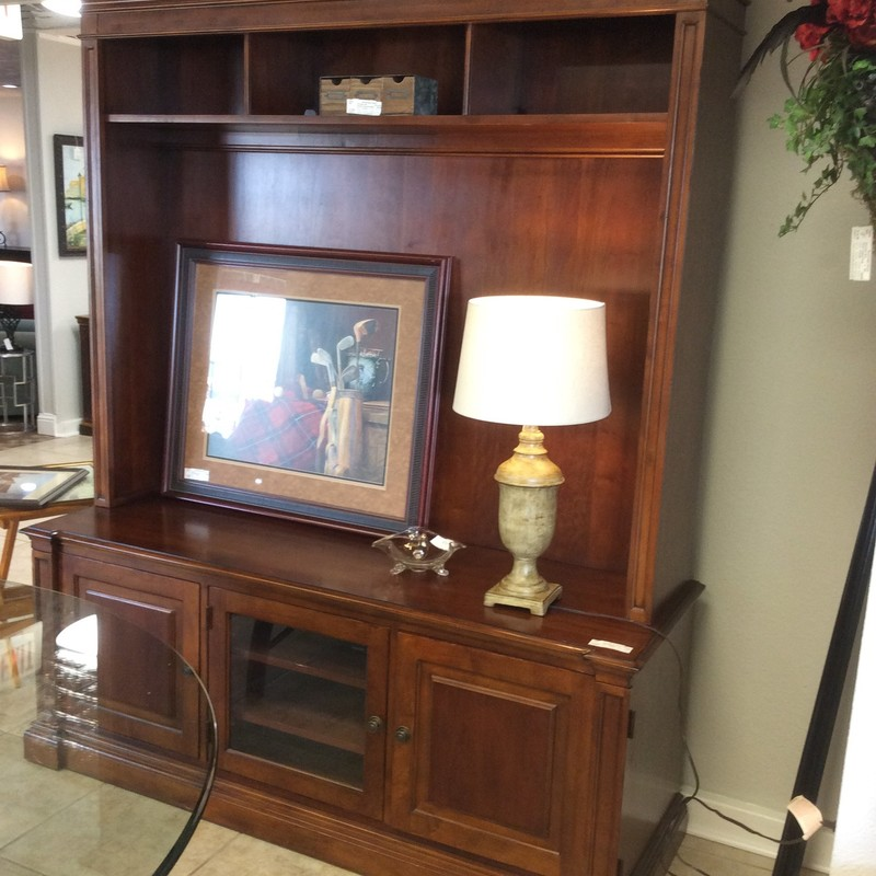 This media center by Ethan Allen is perfect for a smaller space, not over-sized but completely functional. It is from the Cambridge Brown collection and  features storage space with adjustable shelving, cubbies and can accomodate a large screen TV.