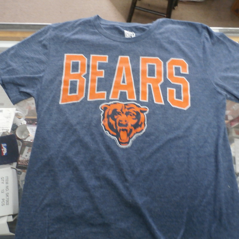 Chicago Bears Shirt, Blue, Size: Medium<br /> NFL Team Apparel Chicago Bears Men&#039;s shirt blue size Medium cotton blend #30071<br /> Rating:   (see below) 3- Good Condition<br /> Team: Chicago Bears<br /> Player: Team<br /> Brand: NFL Team Apparel<br /> Size: Men&#039;s - Medium (Measured Flat: Across chest 18&quot;, length 27&quot;)<br /> Measured flat: armpit to armpit; top of shoulder to the hem<br /> Color: Blue<br /> Style:   Short Sleeve Shirt Screen pressed;<br /> Material: 50% Cotton 50% Polyester<br /> Condition: 3- Good Condition - wrinkled; minor pilling and fuzz; minimal flaws;<br /> Item #: 30071<br /> Shipping: FREE