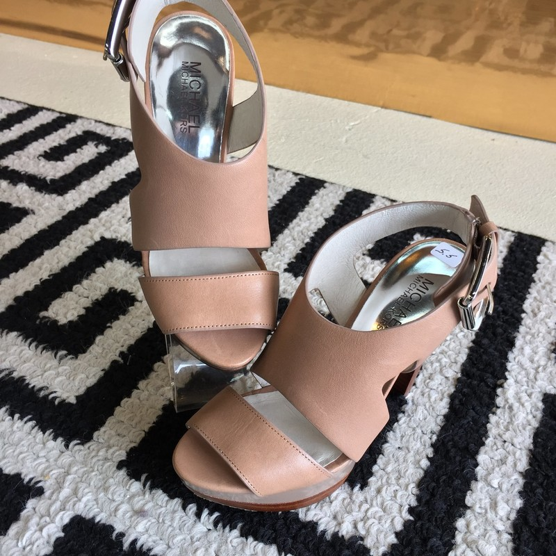 Super stylish, gently used Michael Kors heels. Tan leather exterior with faux-wood heel and platform. Silver hardware. Size 5.5