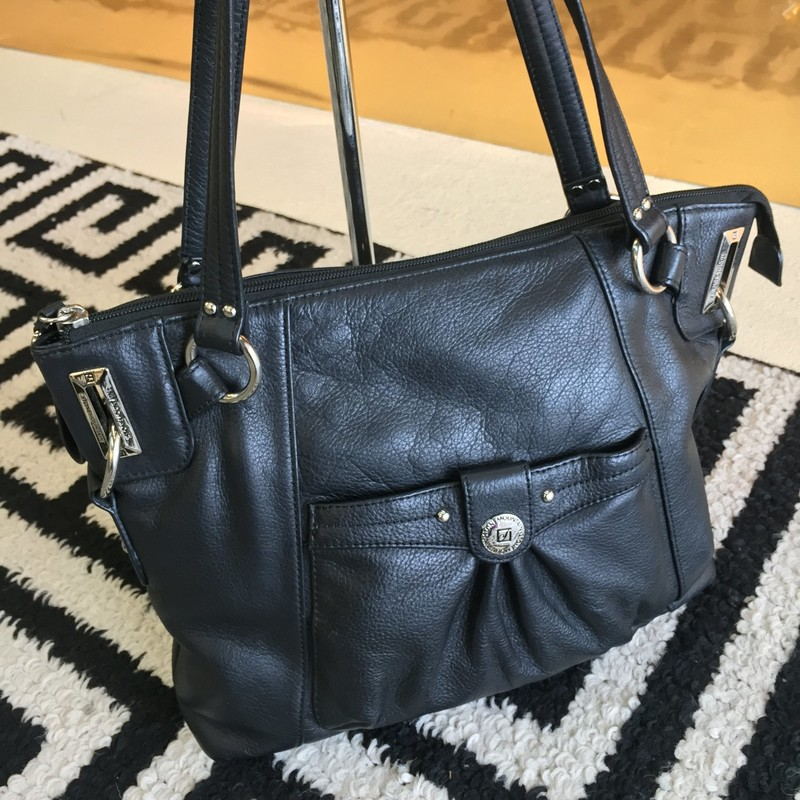 Simple, black leather Stone Mountain purse. Soft, genuine leather with no scuffs or scratches. Silver hardware with pink interor. Retail: $129