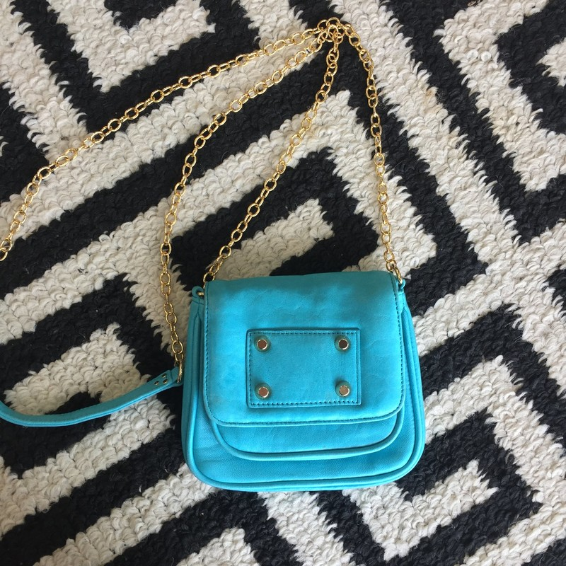 Gorjana crossbody bag with chain strap. Aqua blue soft leather with gold hardware. Great condition with few spotting. Retail: $199