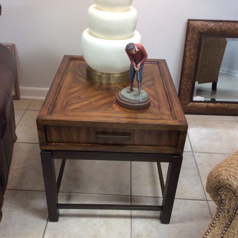 "This is very handsome coffee table set. The coffee table, itself, has 4 inlaid granite tiles, 2 small drawers and 2 larger drawers and 8 ""cubby holes."" The end table has a single good-sized drawer, as well. Both tables sit on sturdy metal bases."