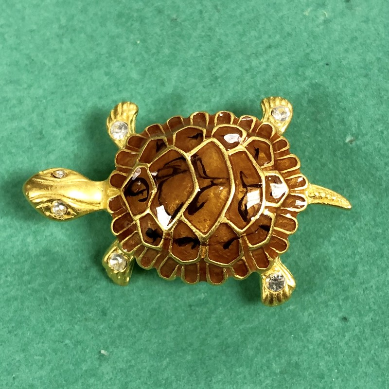 "Premier Designs Turtle Pin<br /> Color: Matte Gold Plating, Brown Enamel<br /> Crystals in Eyes and on each Foot<br /> Measures 3/4"" x 1-3/8"""