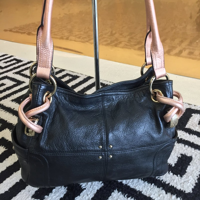 Cute, casual B. Makowsky bag. Black leather with rose gold metallic straps. Gold hardware. Clean, no scuffs. Plenty of pockets. WON'T LAST!