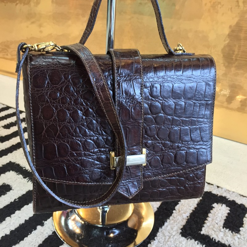 Vintage Lord & Taylor satchel bag. Had one top handle with removable crossbody strap. Genuine brown, gator-like leather with brown leather interior. Gold hardware. Good condition.