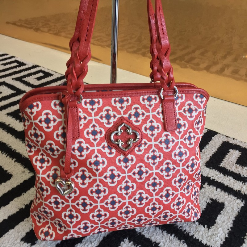 Beautiful Brighton shoulder bag. Gently used, with red leather detailing. Red, white and blue pattern exterior. Includes duster bag. Retail: $289