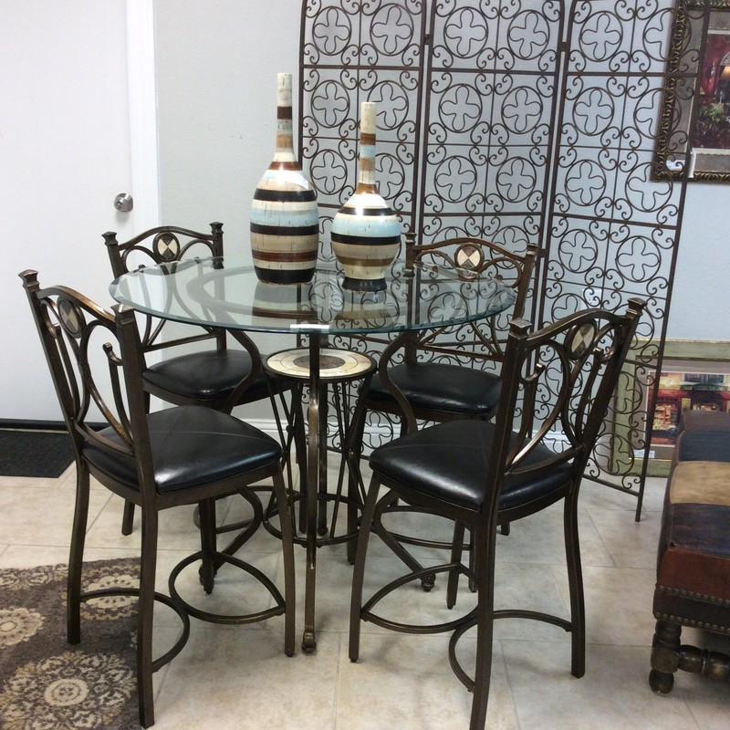 This bistro table is a great buy!  The metal frame of the table features a thick glass top and include 4 chairs. The center of the table base includes a decorative tile inlay as do the chairs.