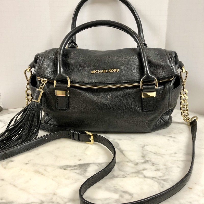 "You'll LOVE this Michael Kors Satchel with it's detachable Crossbody Strap.<br /> Color:Black with Gold Tone Hardware<br /> Approximate Measurements:<br /> 9"" high, 12"" wide, 4"" deep<br /> Material: Soft Pebbled Leather<br /> Features: Two outside end pockets, Leather Tassel, Four Metal Feet.<br /> The back zipper and top zipper BOTH open into the main section of the hand bag! Inside are four pockets<br /> Open the top flap (magnetic metal clasp) to reveal an outside pocket. Inside it is a zippered pocket and six card slots.<br /> This hand bag has been pre-loved and is in excellent condition."