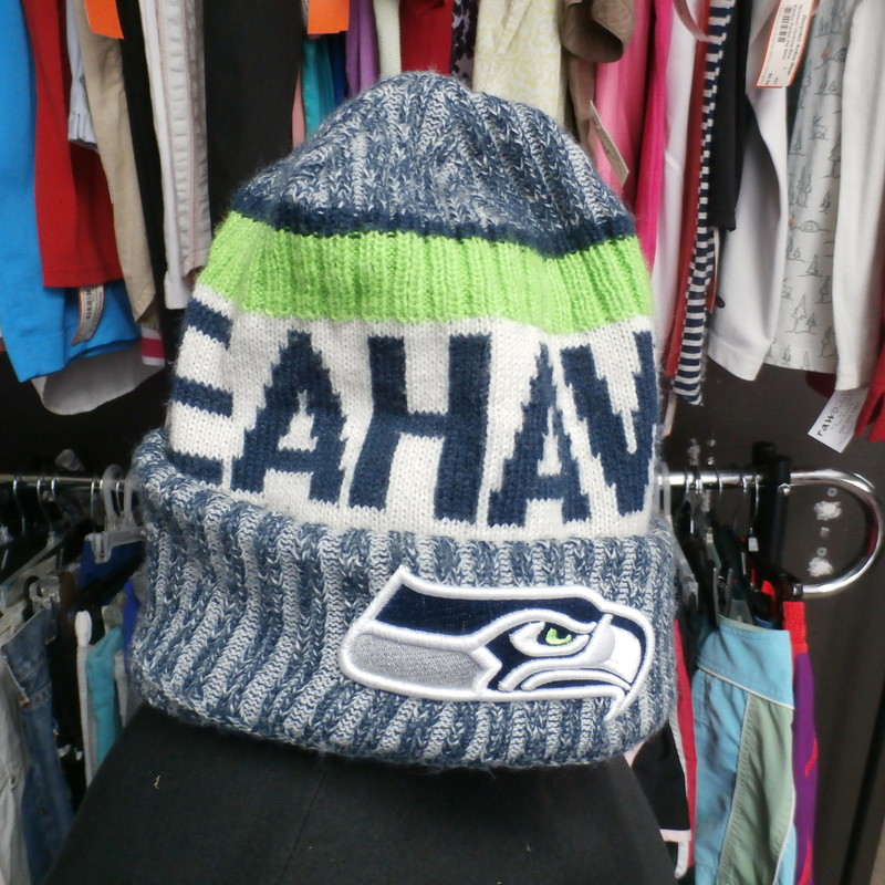 Seattle Seahawks Adult Beanie multi color 30034<br /> Our Clothes Rating: 4- Fair Condition<br /> Brand: NFL<br /> size: Adult OSFM<br /> color: White/ Blue/Green<br /> Style: beanie<br /> Condition: 4- Fair Condition- slightly worn and faded; medium pilling and fuzz; material is slightly stretched out from washing and use; fuzz on the fabric; light staining throughout; slightly misshaped and slouched<br /> Shipping: FREE<br /> Item #: 30034