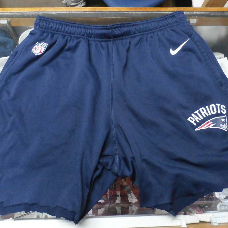 "Men's New England Patriots Shorts size 2XL blue 27974<br /> Our Clothes Rating: 4- Fair Condition<br /> Brand: Nike<br /> size: Men's 2XL- (Waist 16"" Length: 18""; inseam 6"")<br /> color: dark Blue<br /> Style: elastic waistband with drawstring; screen printed has pockets; Sweatpants that were cut to shorts;<br /> Condition: 4- Fair Condition - some wear and discoloration from use; wrinkled ; minor pilling and fuzz; Shorts cut from sweatpants; cut slightly uneven;<br /> Shipping: FREE<br /> Item #: 27974"