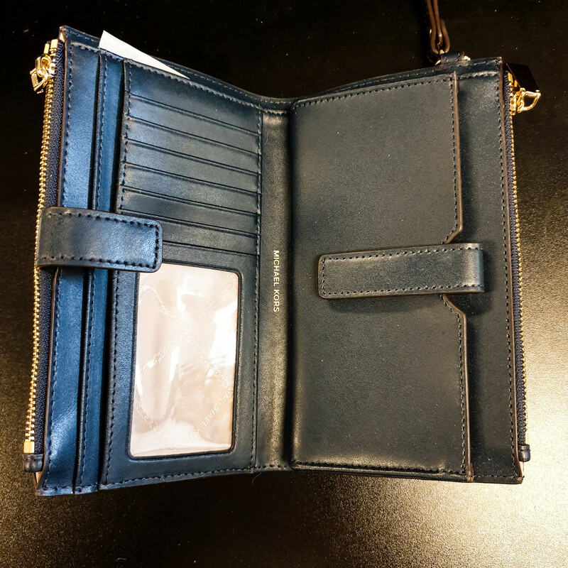 "Beautiful Michael Kors Wallet.<br /> - Blue and white exterior<br /> - ""MK\"" print<br /> - Gold hardware<br /> - Two zip-top closure pockets<br /> - Interior features: six card slips, three slip pockets, ID window and smartphone pocket<br /> - Wristlet included<br /> - W: 7.5 in. H: 4.5 in. D: 1 in.<br /> <br /> * Please note that these measurements and pictures are for reference only and may vary slightly from the original."