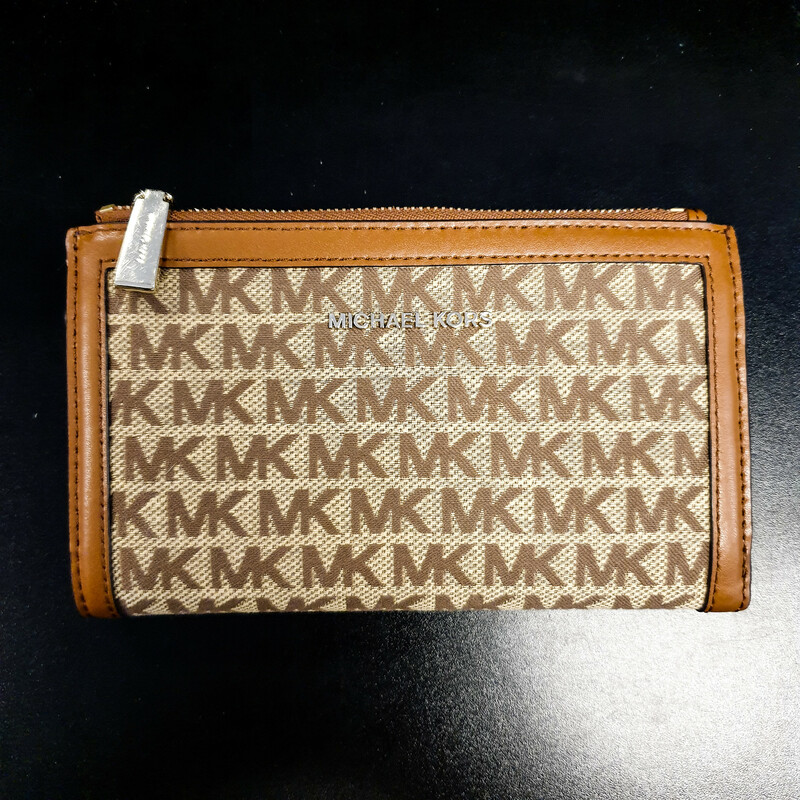 "Beautiful Michael Kors Wallet.<br /> - Brown and tan exterior<br /> - ""MK\"" print<br /> - Gold hardware<br /> - Two zip-top closure pockets<br /> - Interior features: six card slips, three slip pockets, ID window and smartphone pocket<br /> - W: 7.5 in. H: 4.5 in. D: 1 in.<br /> <br /> * Please note that these measurements and pictures are for reference only and may vary slightly from the original."
