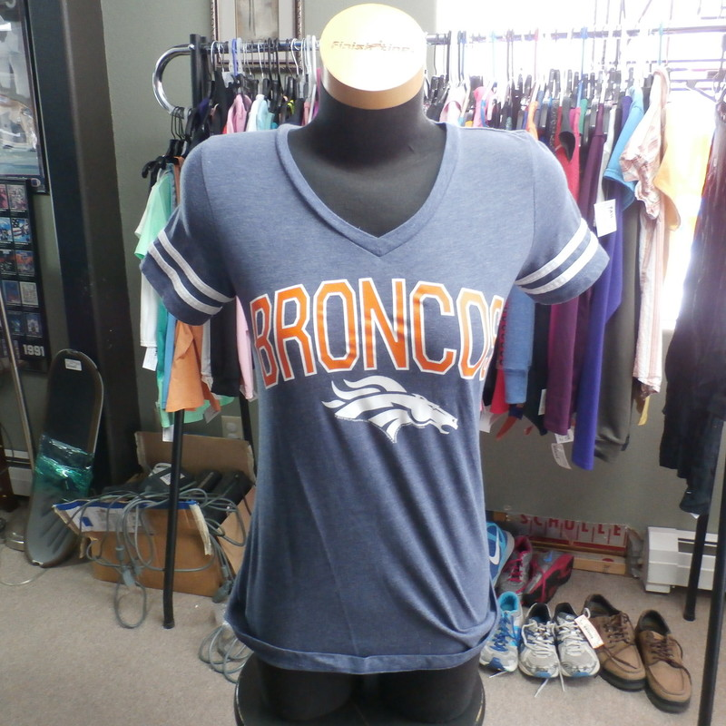 "Den Broncos Womens, Blue, Size: Small<br /> Women's Denver Broncos V Neck T Shirt size Small 30556<br /> Our Clothes Rating: 3- Good Condition<br /> Brand: NFL Team Apparel<br /> size: Women's Small- (Chest: 15"" Length: 24"")<br /> color: blue<br /> Style: screen pressed short sleeve shirt<br /> Condition: 3- Good Condition- slightly worn and faded; light pilling and fuzz; material is slightly stretched out from washing and use; fuzz on the fabric; wrinkles; faded;<br /> Shipping: FREE<br /> Item #: 30556"