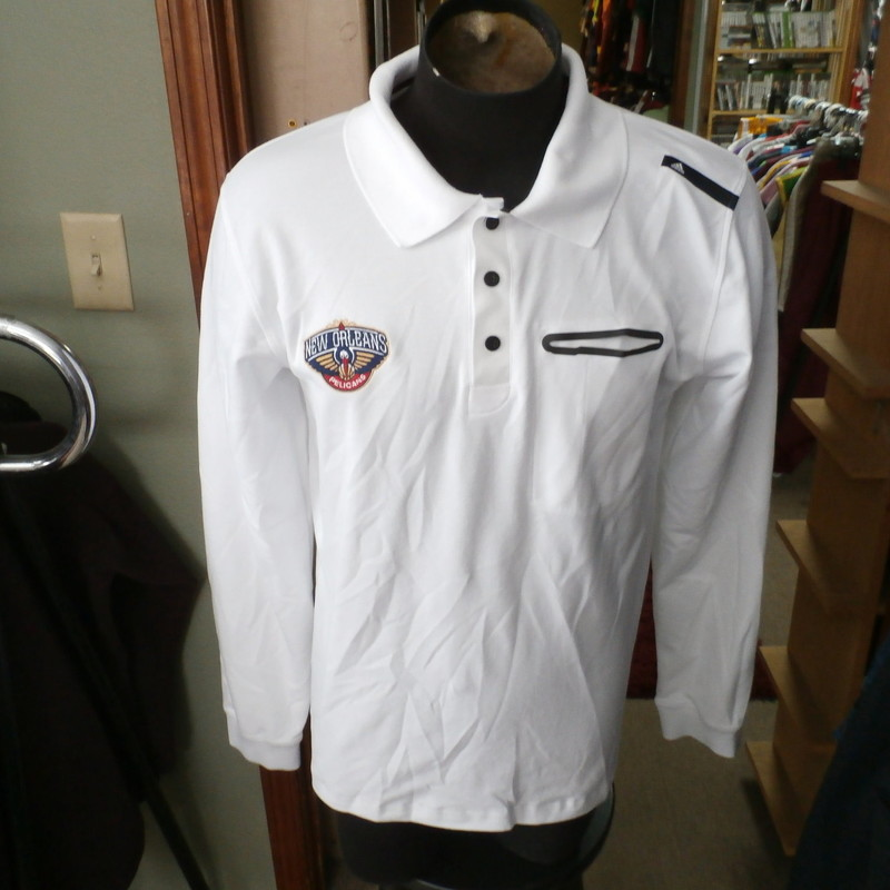 "New Orleans Pelicans long sleeve polo white size XL #30688<br /> Our Clothes Rating: 3- Good Condition<br /> Brand: adidas<br /> size: Men's XL- (Chest: 21"" Length: 29"")<br /> color: White<br /> Style: embroidered logo; collared polo; long sleeve; bottom is longer in the back<br /> Condition: 3- Good Condition- there are sweat stains on and around the collar; wrinkles;<br /> Shipping: FREE<br /> Item #: 30688"