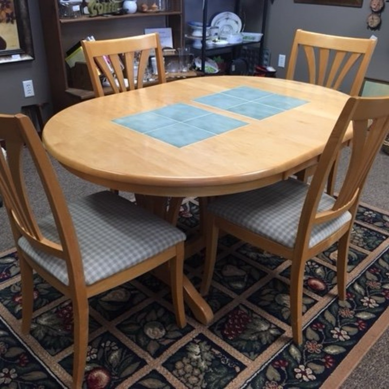 Beautiful maple table with tile inlay.  Originally from Gariel Furniture.  Comes with 4 chairs and a leaf.