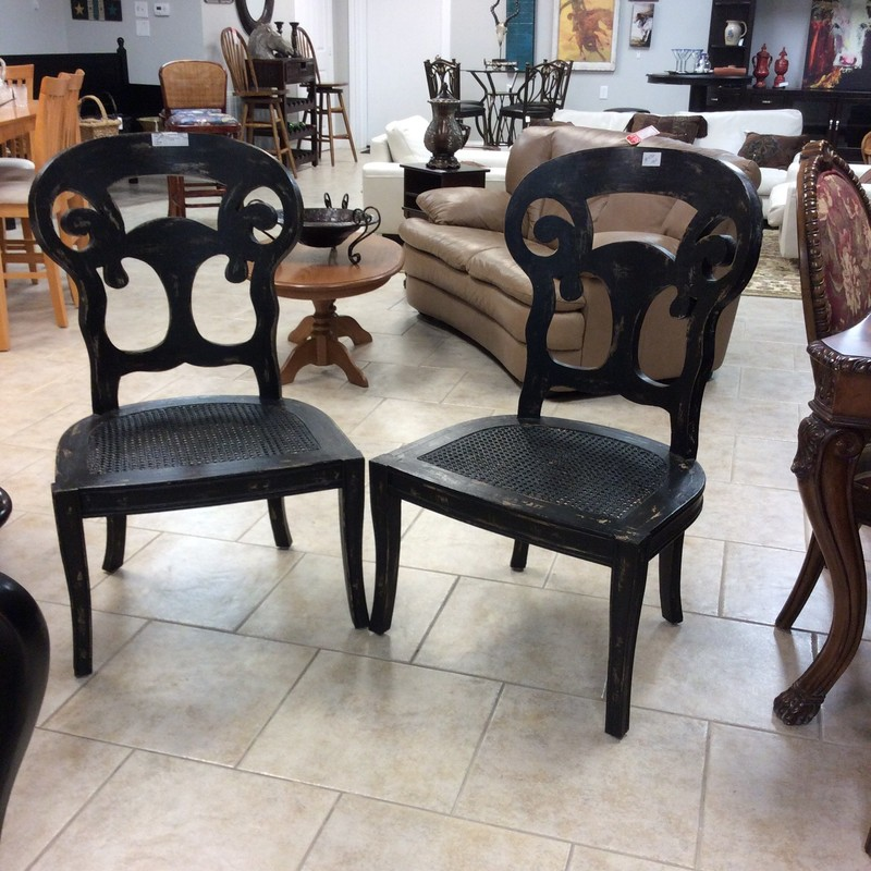 "This is the deal of the week! This super-sized pair of wood and cane chairs have been priced to move. Painted black and distressed the seats are cane and 25"" in width. They are originally  from GuildMaster. One of the chairs has sustained some damage."