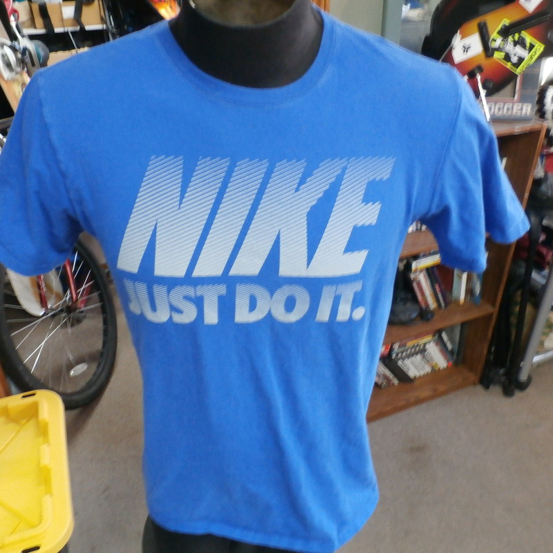 "Nike ""Just Do It"" blue tee size medium #30562<br /> Our Clothes Rating: 3- Good Condition<br /> Brand: Nike<br /> size: Men's Medium- (Across chest: 20"" Length: 26"")<br /> color: blue<br /> Style: short sleeve; screen printed<br /> Condition: 3- Good Condition- some wear and fading from use and washing<br /> Item #: 30562<br /> Shipping: FREE"