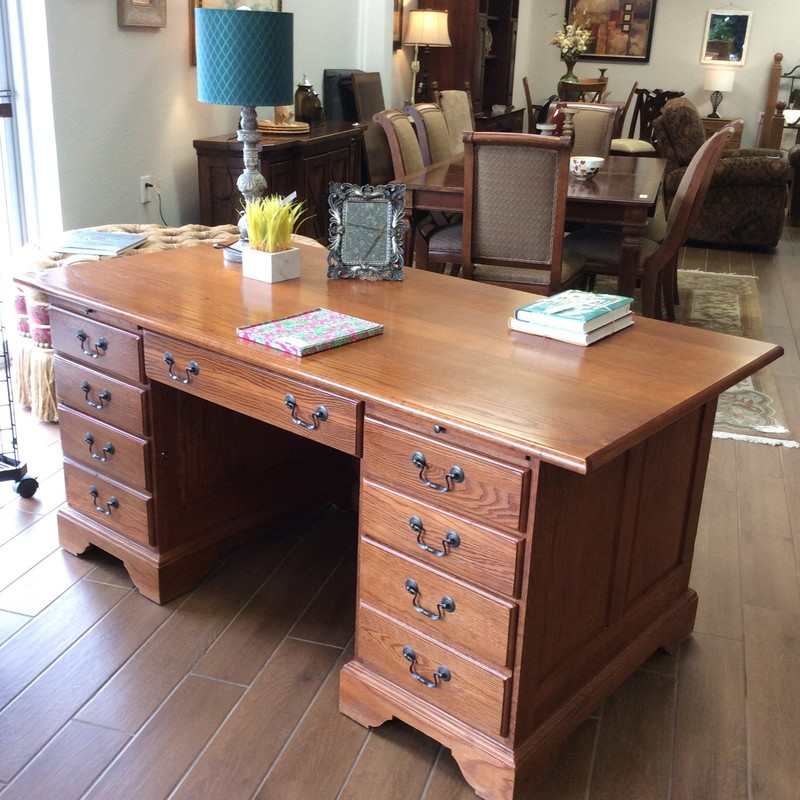 This oak desk  by Riverside Furniture Company is from the Sutter's Mill Collection.  It's oak -  solid, hearty and quite large. It features 7  drawers, 2 of which are filing cabinets. It also includes 2 pull-out trays.