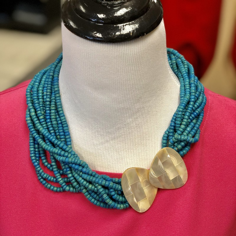 "Estate Jewelry!<br /> Vintage Necklace<br /> Features twelve strands of small wood beads.<br /> The clasp is Mother of Pearl on wood backing.<br /> Color: Turquoise<br /> *please note the small section of M-O-P missing from one clasp. This section is hidden when clasps are closed.<br /> Length: 20"", and may be shortened by twisting the strands."