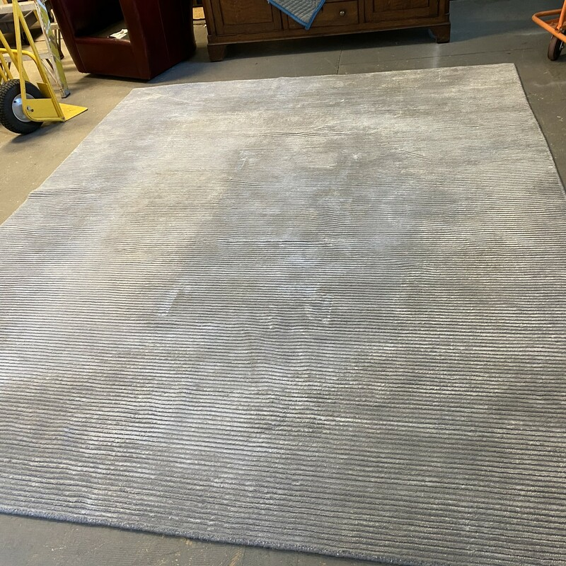 Ribbed Modern Wool Rug, Gray, Size: 8x10<br /> <br /> Damage on rug, has furniture holes dug into weave. Can be covered with furniture. Still a lovely rug with years of life in it.