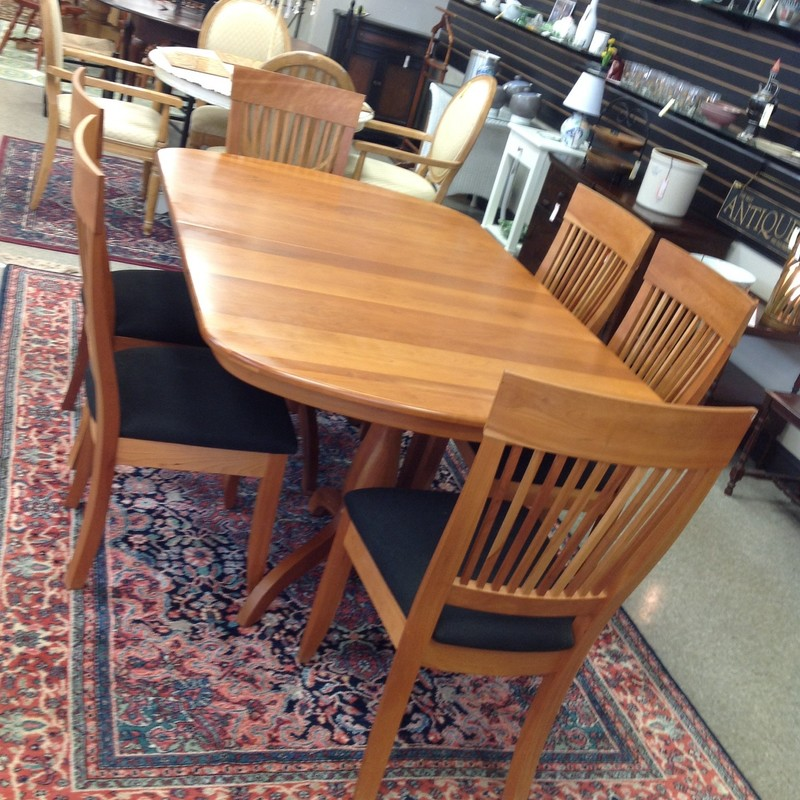 Le Mieur cherry double pedestal dining table with 10 armless chairs. Size: 68x42 not extended, extends to 114 inches with 4 leaves. Leaves are self stored and 11 inches wide each.