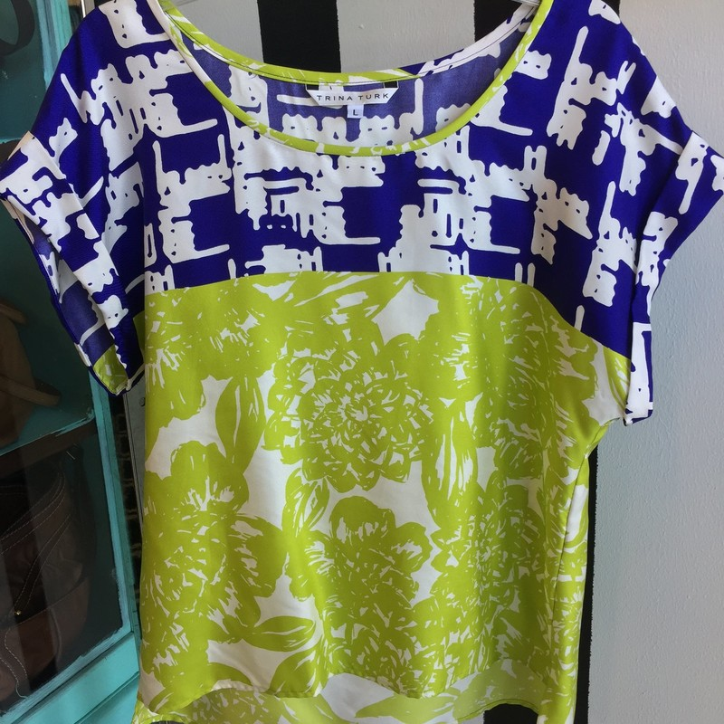 Trina Turk short sleeved top, size large. Green, navy and white silk. Dry clean only. Like new, retail approx: $188