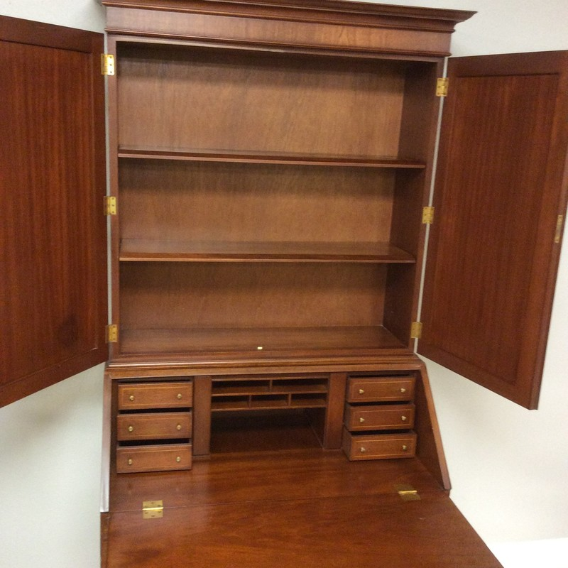 Isn't this a lovely BIGGS secretary/desk? It features solid wood construction, a gorgeous cherry finish, 4 roomy drawers (each with a lock and key!) additional upper storage shelves, and lots of small drawers/cubbies hidden within.