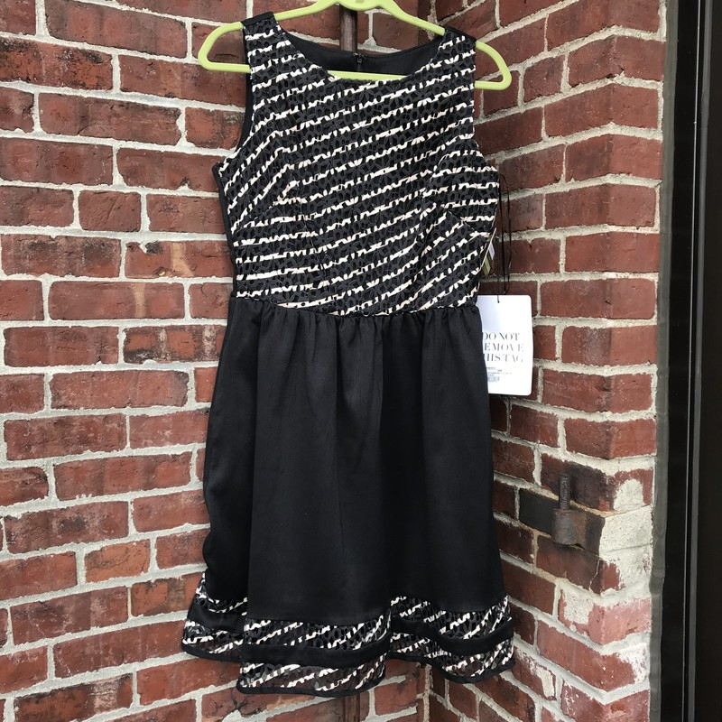 Sleeveless dress by Taylor.  Black skirt with woven lace design of black and beige on the bodice and the hem.  Size 8 NWT