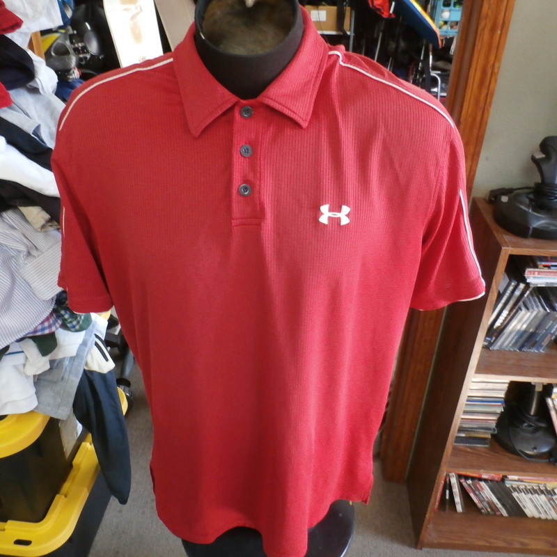 "Under Armour red polo shirt size Large polyester blend #30123<br /> Rating: (see below) 3- Good Condition<br /> Team: n/a<br /> Player: n/a<br /> Brand: Under Armour<br /> Size: Men's Large- (Measured Flat: Across chest 24""; Length 30"")<br /> Measured Flat: underarm to underarm; top of shoulder to bottom hem<br /> Color: red<br /> Style: short sleeve; embroidered<br /> Material: 95% polyester 5% spandex<br /> Condition: 3- Good Condition: minor wear and fading from use; some small snags on back (see photos)<br /> Shipping: FREE"