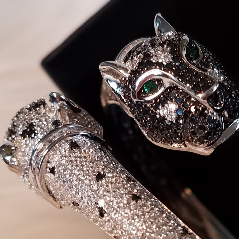 Cote d' Argent Panther Jaguar Double Headed Bangle Bracelet that is NWT.<br /> The Panther Jaguar theme is beautiful. The onyx with the pave CZ crystals really stand out with the emerald eyes.Perfect to make a statement in the workplace, at your next social party, shopping, night on the town or dinner. You will receive lots of compliments on this outstanding conversation piece! Don&#039;t miss your opportunity to own this Bracelet.<br /> New $308