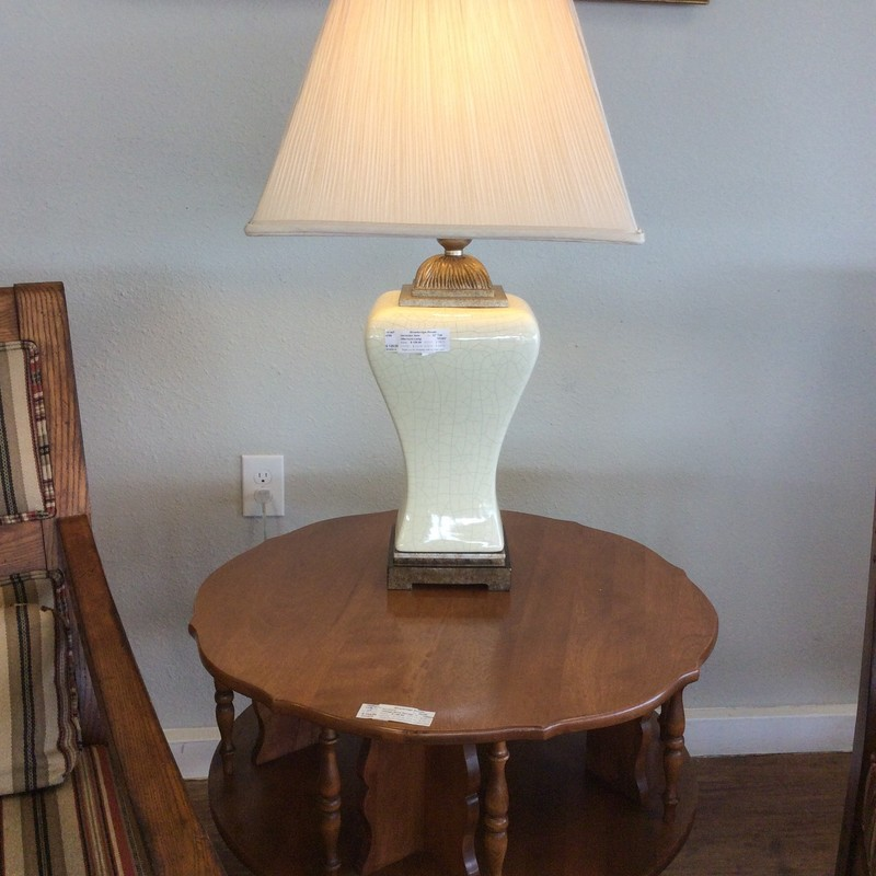 This is a beautiful lamp by Uttermost. Uttermost brings fashion-forward accessories season after season and this lamp is no exception. The base is a yellow/ cream with a crackle -  type appearance and a neutral colored pleated shade.
