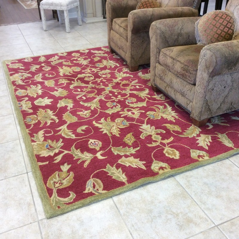 "This pretty CHANDRA rug would brighten up any room. It is 100% woolen pile, the pattern is ""Cranberry"", the colors are red, golds, sage and turquoise, and is was made in India. Stop by and check it out!"
