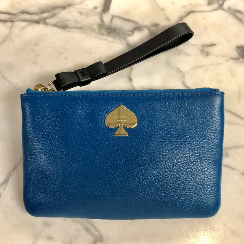 Kate Spade Wristlet, pre-loved, excellent condition!<br /> Size: .5&quot; thick x 6.5&quot;  wide x 4.25&quot; high.<br />             Handle is 1/2&quot; wide x 4&quot; long<br /> Material:<br /> Exterior: pebbled leather exterior, teal color<br /> Interior: signature black and white stripes, polyester<br /> Strap: smooth black leather featuring a cute little bow<br /> Hardware: gold tone zipper and gold tone engraved spade-shaped emblem on exterior.