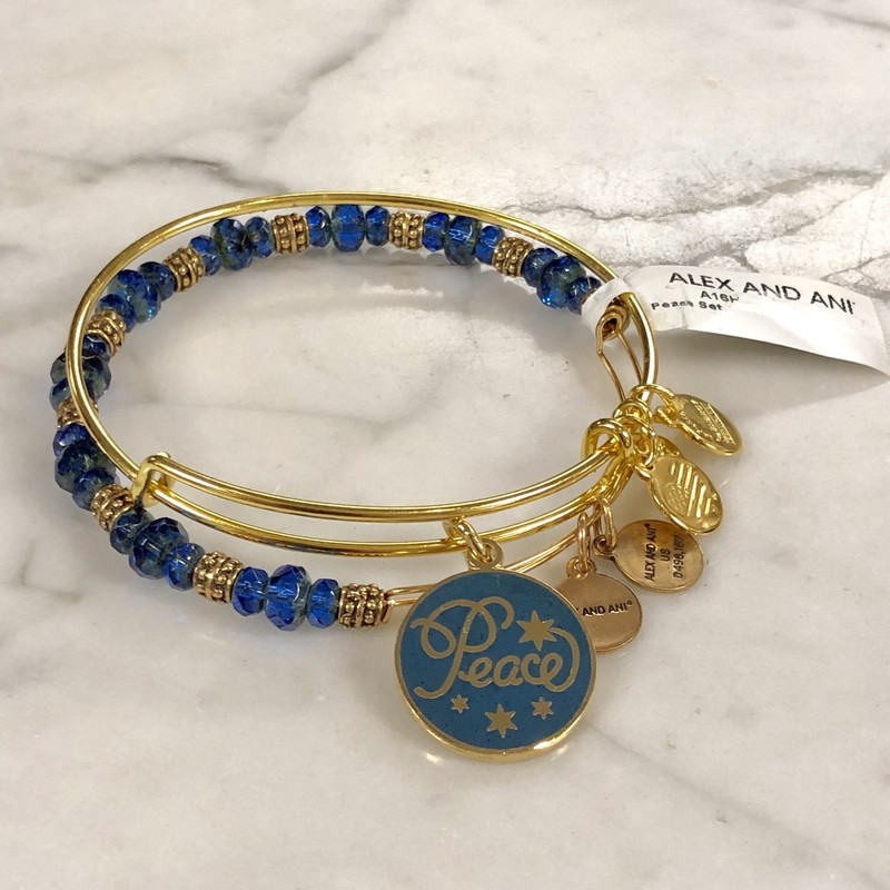 "Alex And Ani Double Bracelet. NWT<br /> Features a round blue and gold charm with ""Peace"" on one side, all gold on the other.<br /> One bracelet is all gold tone, the other is gold tone with blue and gold beads/spacers<br /> Retails for $38+ on Amazon. Our Price: $20"