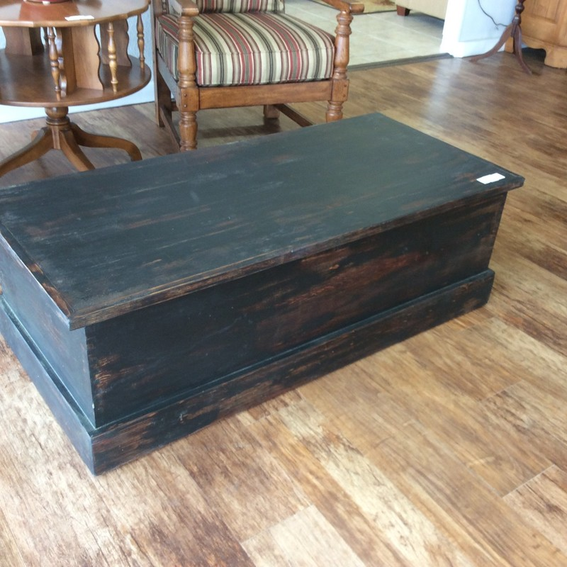 This piece does double duty as both a trunk and a coffee table, cool! The interior is pine, the outside has been painted black and distressed. It has a spacious interior, perfect for blankets and bedding. A handsome piece indeed!