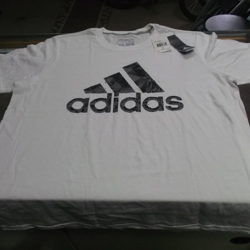 "Adidas ClimaLite Men's The Go-To Tee Size XL White Polyester Blend NEW #9006<br /> Rating:   (see below) 3 - Good Condition <br /> Team: n/a<br /> Player: n/a<br /> Brand: Adidas<br /> Size: XL - Men's(Measured Flat: Across Chest 23""; Length 29"") Top of shoulder to the hem<br /> Color: White<br /> Style: Athletic Short sleeve shirt; ClimaLite<br /> Material: 60% Polyester 40% Cotton<br /> Condition: - Good Condition - wrinkled; Original tag never worn, light pilling and fuzz; Light stain on the back; No rips or holes(See Photos for condition and description)<br /> Originally $25 which is on the price tag<br /> Shipping: $3.37<br /> Item #: 9006"