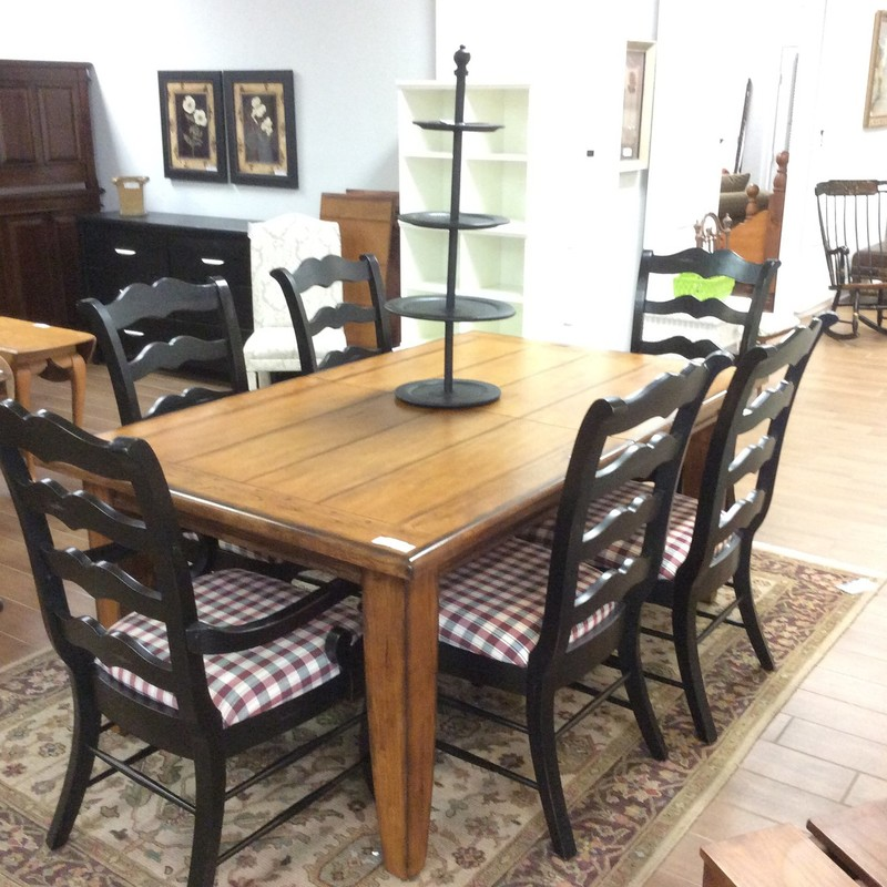 This handsome dining set is in very good condition. The solid wood table has two 18 inch leaves, and when they are inserted, the table measures a full 9 feet long. The country french style chairs feature solid wood construction, a matte black finish and red/white/black plaid upholstered seat cushions.