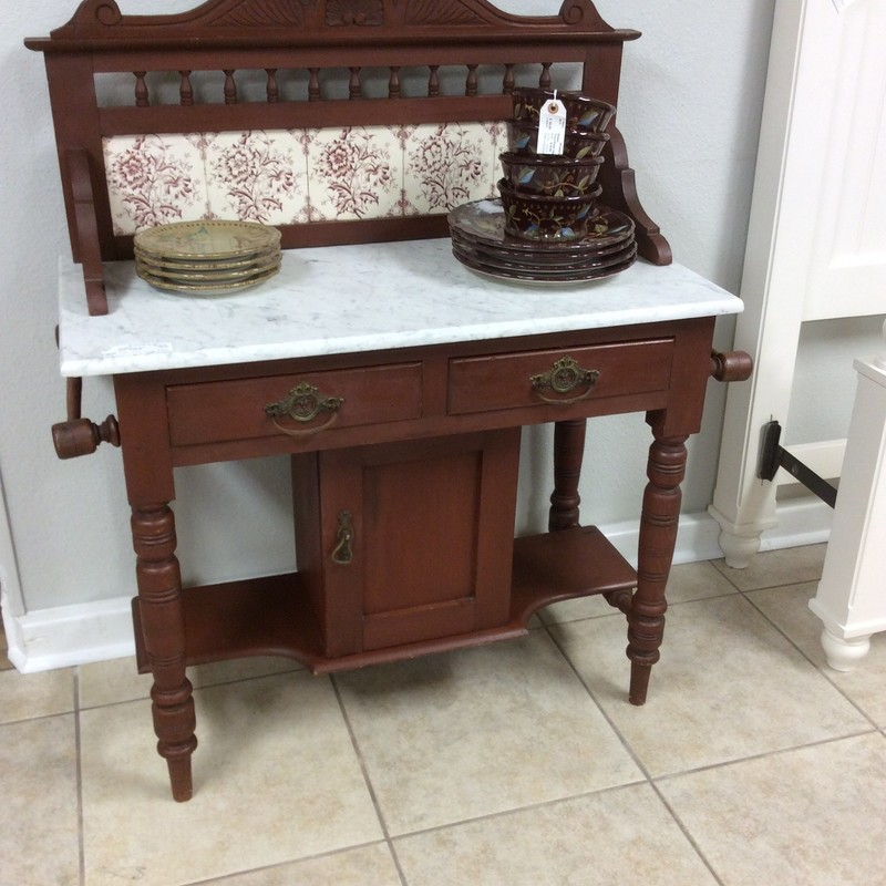 This older piece of furniture will take you back to a simpler time! Full of charm and character, this vintage wash stand will add a touch of romance to any room, be it bathroom or guestroom. It combines wood with marble, metal and tile and features 2 small drawers with dovetail jointing. The bottom has a 2-tier shelf for extra storage. You will love this!