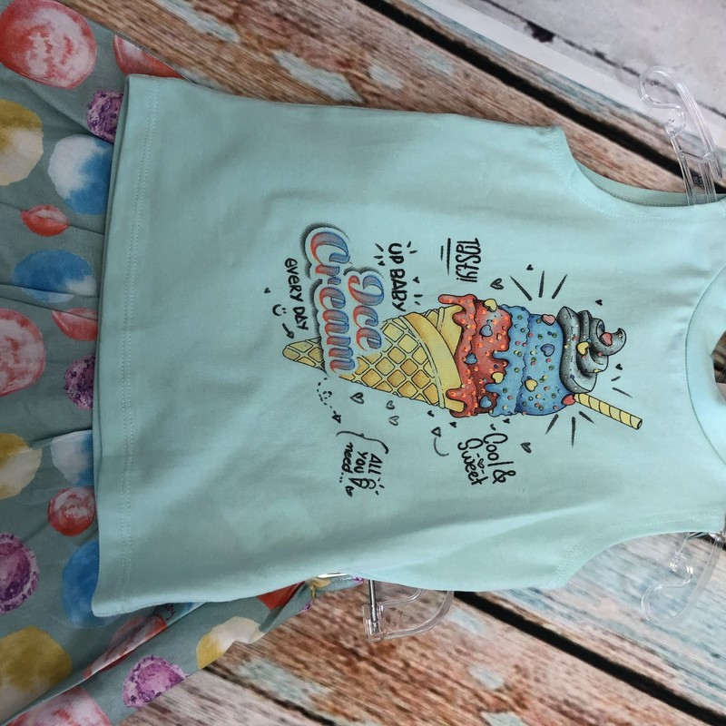 NEW UpBaby 2 piece outfit.  The shirt is sleeveless with an ice cream cone and the skirt has circles in the same color as the shirt.  The skirt has built in shorts underneath.