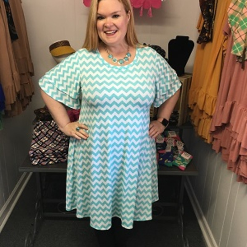 Our Chevron Print Pocket Dress is now available and looks gorgeous on. You can wear this to any occasion. The material has a lot of stretch made of 92% Polyester 8% Spandex with a length of 37 in