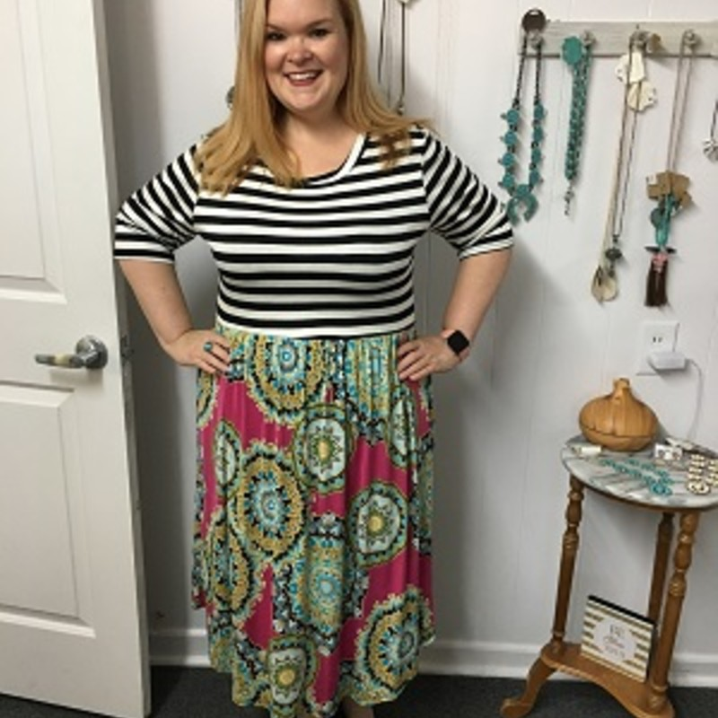 Our Striped Medallion Midi dress is now available and looks gorgeous on. You can wear this to any occasion. The material has a lot of stretch made of 95% Rayon 5% Spandex with a length of 44.5 inches.