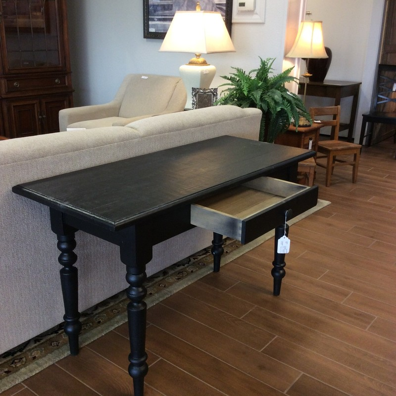 This very nice sofa table has been painted black and features a single drawer with dovetail jointing.