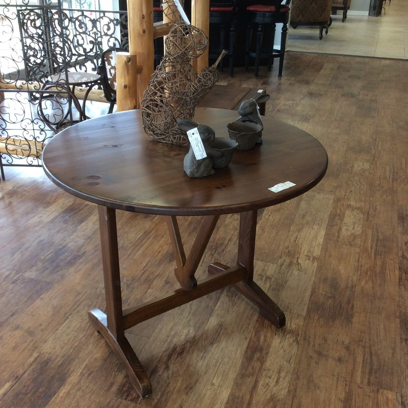 This tilt top table by Ethan Allen is the perfect smaller accessory table for really any room or use but especially if you have a smaller home or apartment. A  lovely combination of beauty and function, the table, which is pine, has a base that  pivots to the center and the table top tilts to a vertical position. This is a nice benefit  if you have limited space and/or the table needs to be stored. It makes for a very slim profile. Come by soon and take a look!