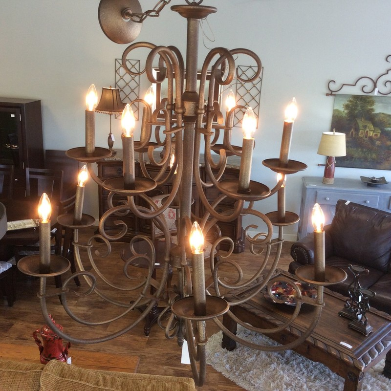 This is a really pretty chandelier. It is made entirely of wraught iron, and has an antiqued bronze finish. The 12 spidery arms each hold a candelabra bulb. You can even add shades to it if you wish.